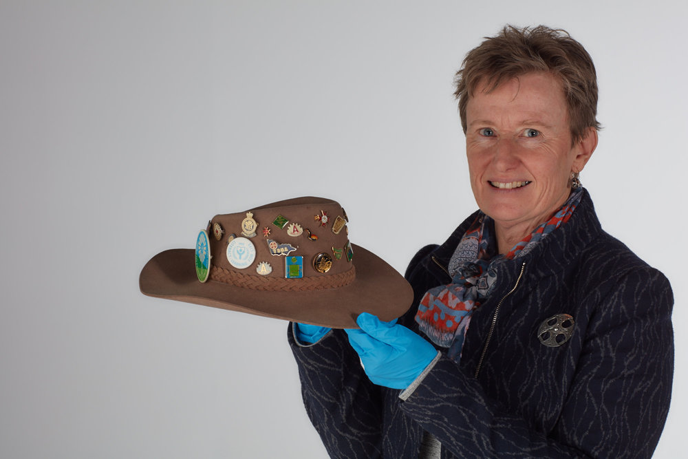 Liza Dale-Hallett holding an item in the Invisible Farmer Collection,  Heather Mitchell's hat  (currently on display at Melbourne Museum), Melbourne Museum, 2017, Source: Museums Victoria