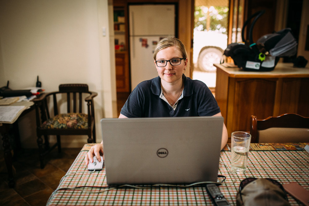 Emily Mueller at her laptop computer doing accounting and book-work, photographed by Catherine Forge, Source: Museums Victoria:  https://collections.museumvictoria.com.au/items/2243782