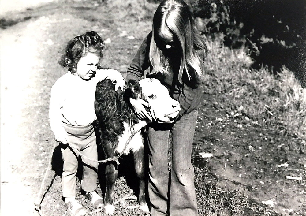 Rebecca Spangaro (left) with her sister Gabrielle (right) holding a calf, 1974. Photo: supplied by Aileen Spangaro.