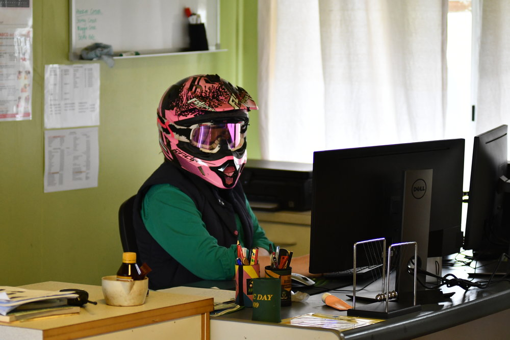 Laura captions this photo of herself, 'demonstrating OHS principles in the office'! For Laura, her duties include a combination of office work and outdoor work, image supplied by Laura Lewis.