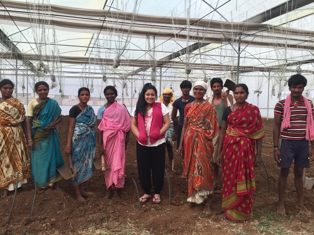 Rayali whilst interning with the University of Agricultural Sciences in Bangalore, India. Here she learns how to till soil manually with a local farming group.