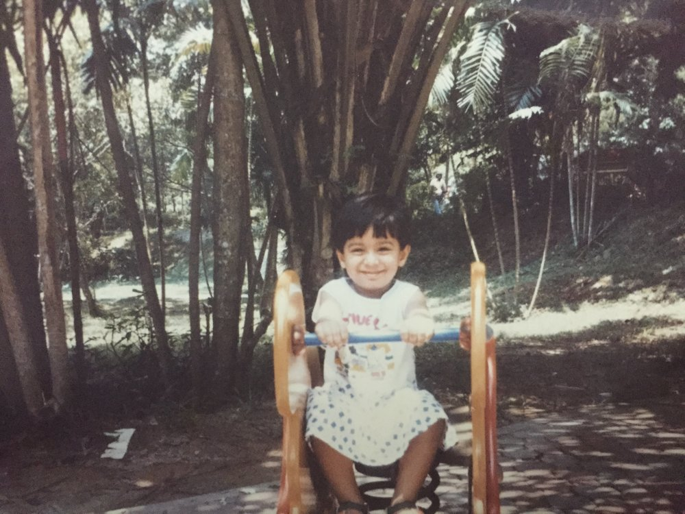 Rayali enjoying an outdoor park in Singapore as a toddler.