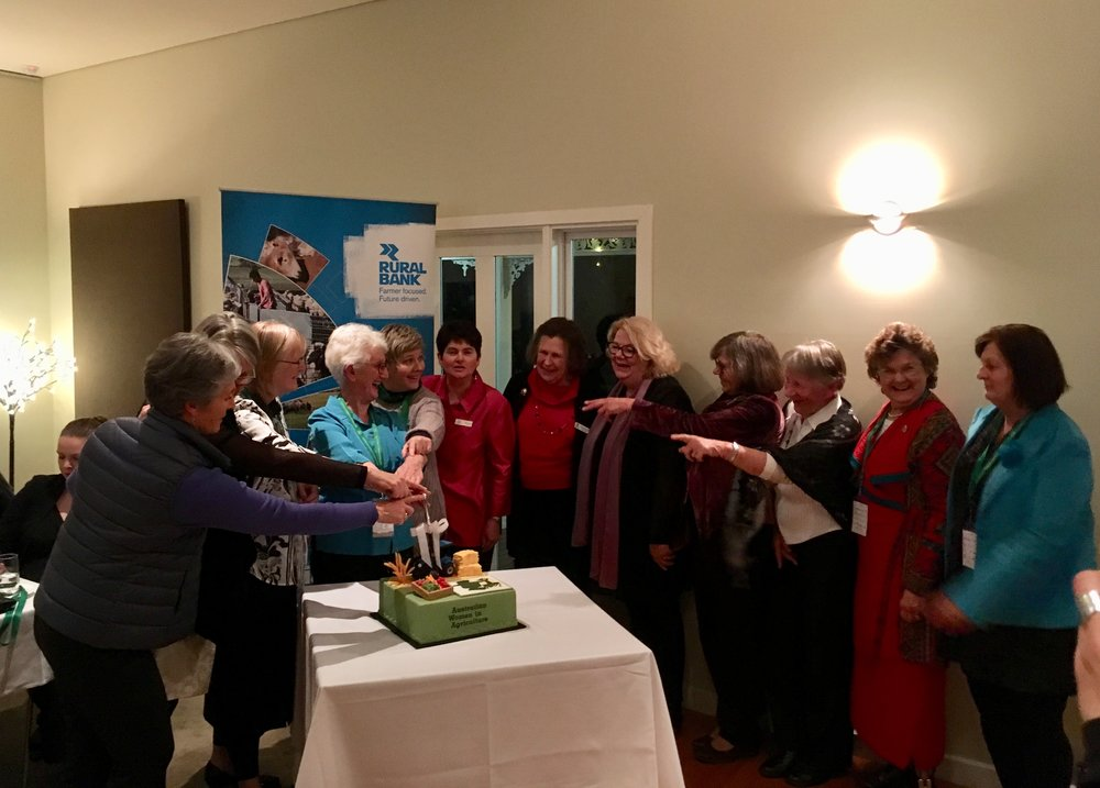 Longstanding members of Australian Women in Agriculture (AWiA) cutting the 25 Year Anniversary cake at the Shepparton Conference Gala Dinner, 18 August 2018. Photo: Catherine Forge (Museums Victoria).