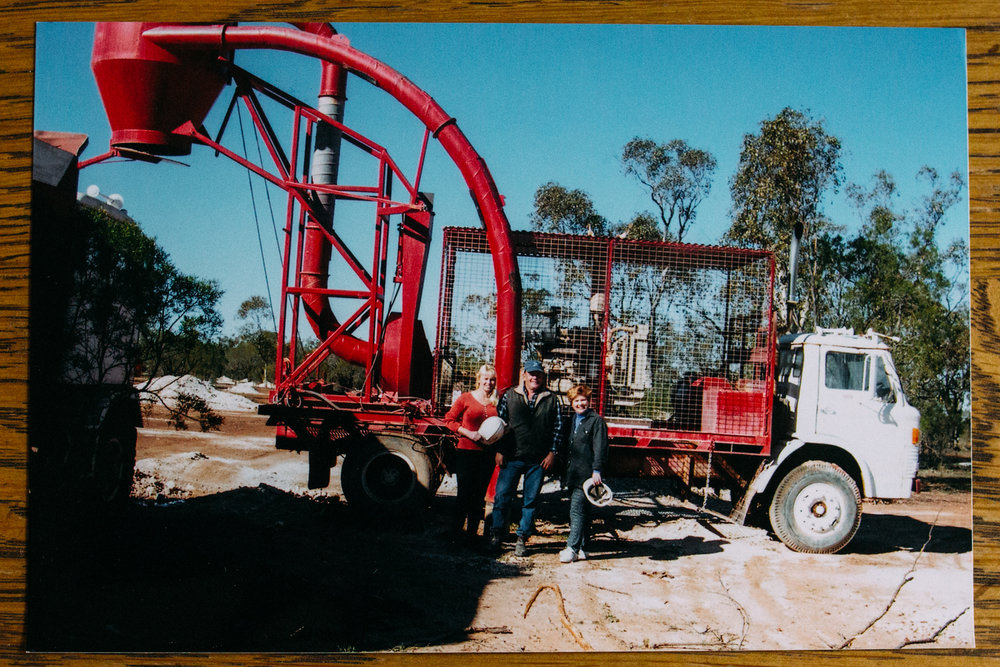 Sally Hall, Peter Hall and a friend with a piece of mining equipment, Lightning Ridge (New South Wales), 2002, Image: supplied by Sally Hall.