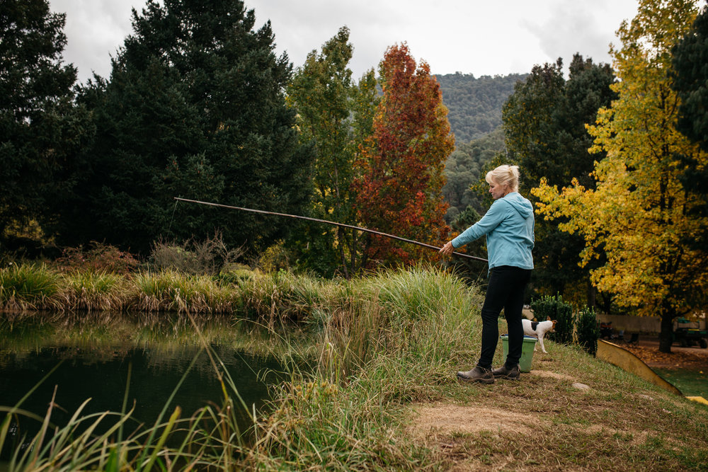 Sally Hall fishing for trout with a bamboo fishing rod, Mountain View Trout and Salmon Farm, Harrietville (Victoria), 2017, Photographer: Catherine Forge, Source: Museums Victoria [MM 145580:  https://collections.museumvictoria.com.au/items/2241623 ].