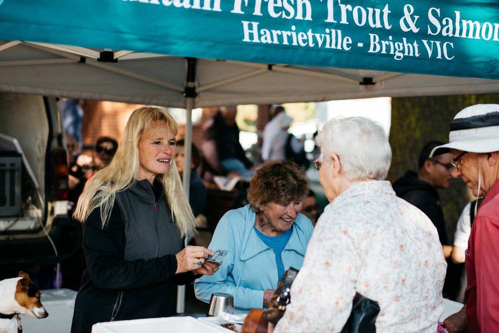 Sally Hall and her mother Rita Baldwin serving customers at the Bright Farmer's Market (Victoria), 2017, Photographer: Catherine Forge, Source: Museums Victoria.