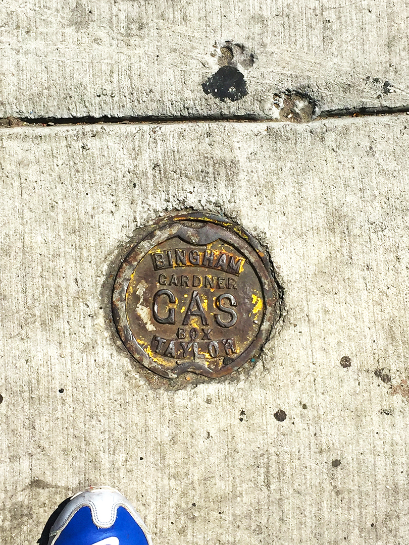 Gas cap & dog paw prints. Division Street.