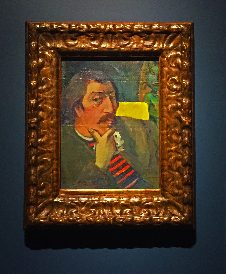 Portrait of the Artist with the Idol, about 1893. Paul Gauguin. Oil on canvas.  Here, Gauguin is straddling his two worlds ... Tahiti and France. He knows the power of the island mythology and its idols, but he needs to assume his position of the civilized European ... so he wears the familiar blue and red striped French shirt with a suit jacket, but the Tahitian idol hovers in the background. I think at this point, he's trying to figure it all out. Fascinating life he led ... I'm not keen that he abandoned his family to do it, but that's what happened.