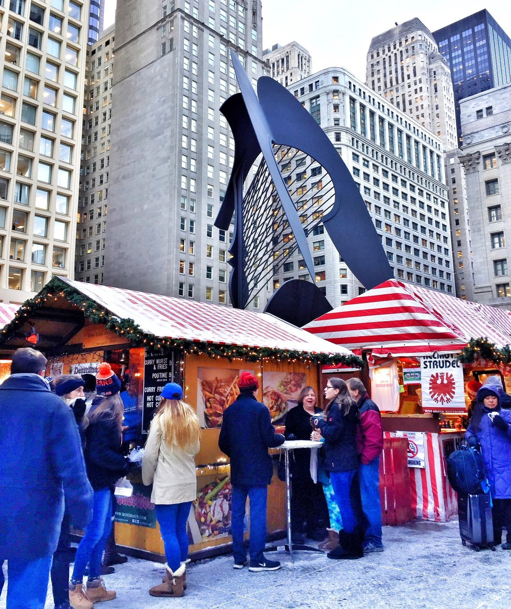 The Pablo Picasso sculpture in the middle of the Christkindlmarket.