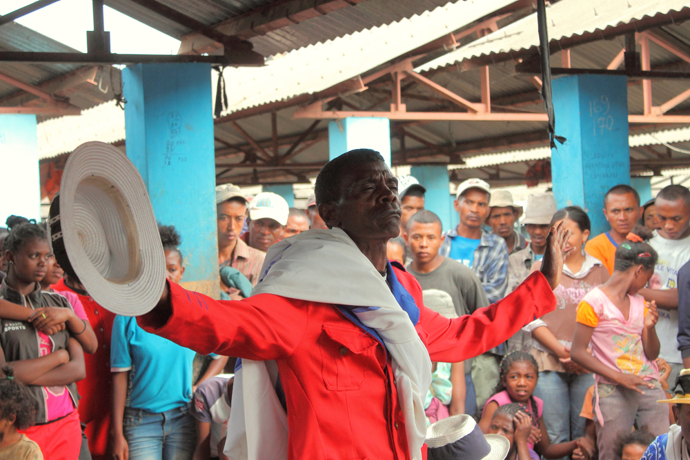 Emile performs in Namontana market, a gathering place for farmers wanting to buy and sell agricultural goods on Antananarivo's outskirts