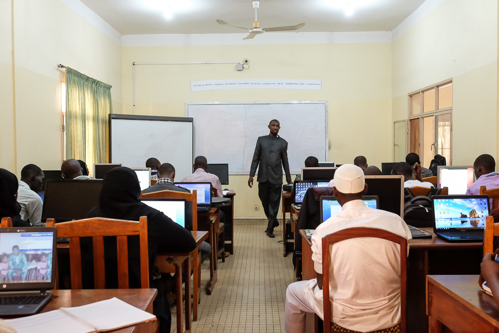 Students in a mathematics and computing class at the university. A digital network connects classrooms and computers across the entire university.