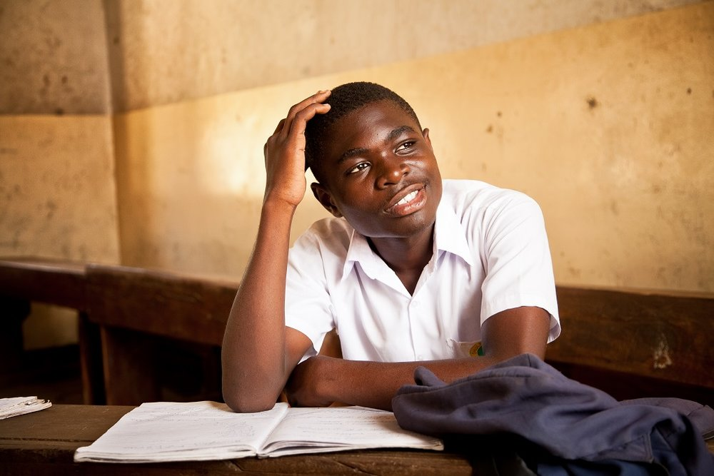 Jackson, 16, once thought he would never get an education. Though he was enrolled in school, his family made him work selling soap at a local market. Eventually he went to stay with an aunt who took him to Kigamboni Community Centre's Drop Out School. After just one year, Jackson passed the entrance exams that allowed him to return to mainstream schooling. Now, he is top of his class.