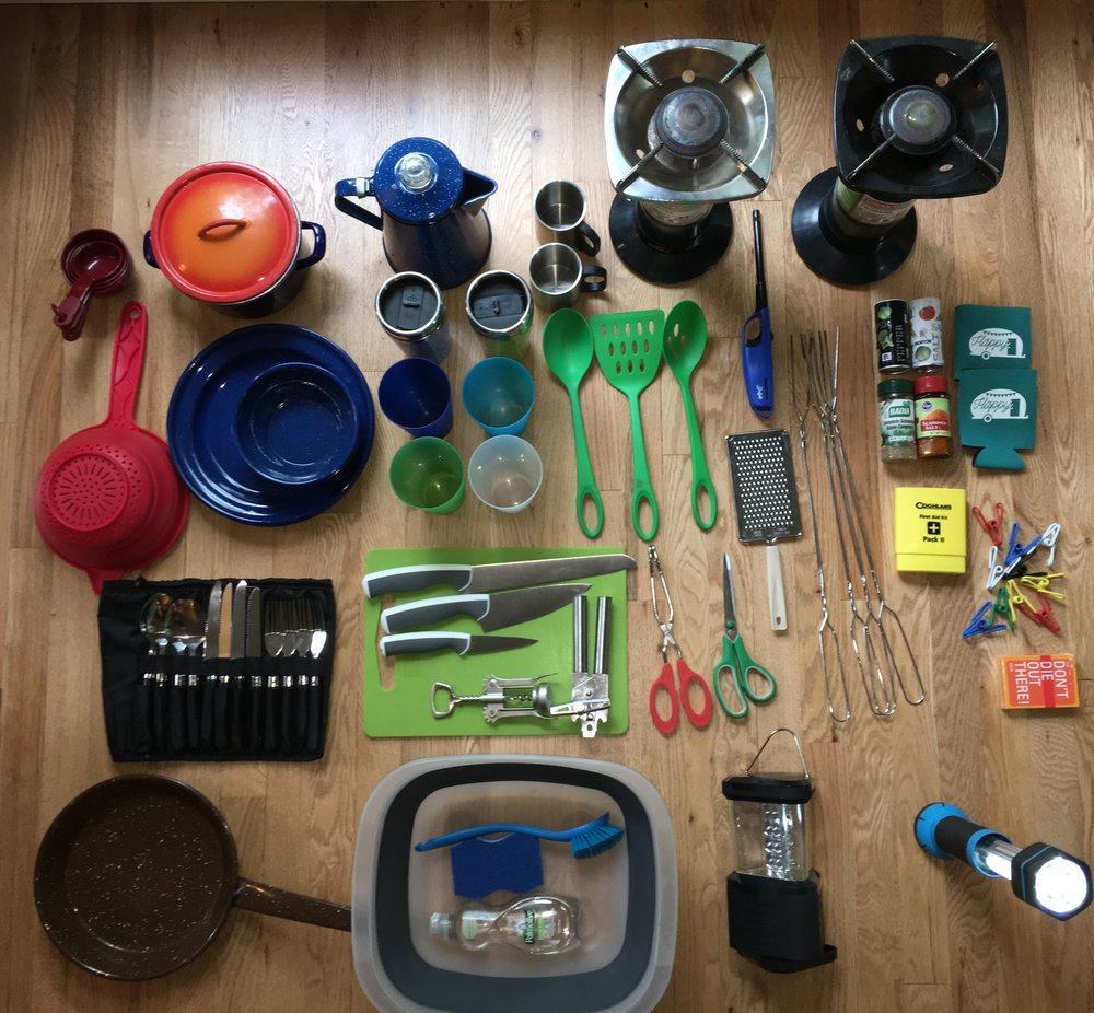 Included Kitchenware: - -4 plates-2 Coffee cups-2 Coffee travel mugs-4 Tumblers-1 skillet-Colander-Coffee Percolator-Forks/Spoons-KnivesCutting board-Tongs-Can & wine opener-Dish washing tub-Sponge-Spices-Table cloth