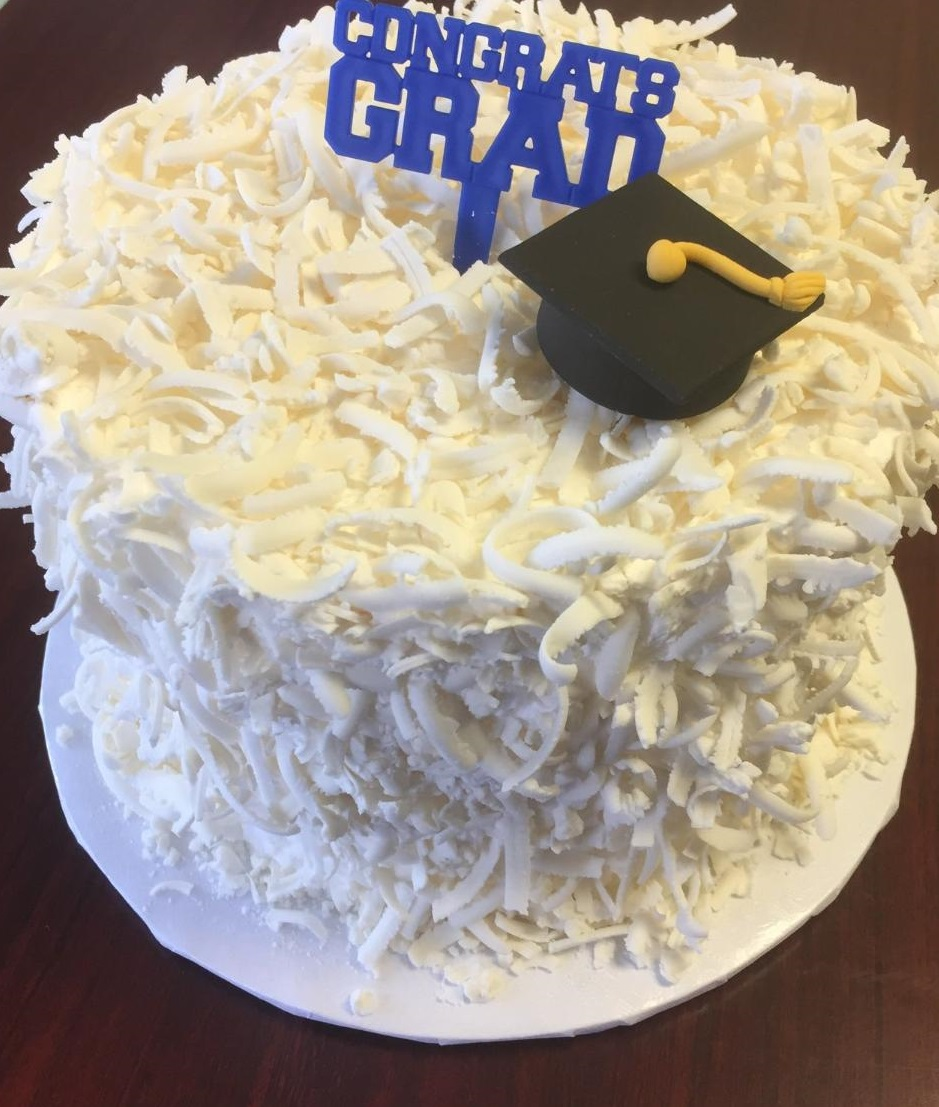 Signature frosting with 3D grad cap and pick