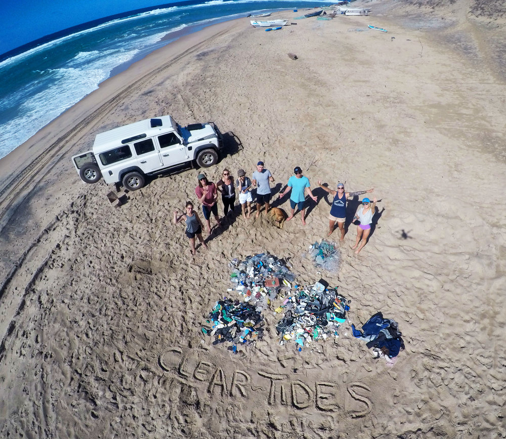 A group shot from Zavora Beach, Mozambique, where we collected over 2000 pieces of rubbish , in collaboration with Marine Action Research .