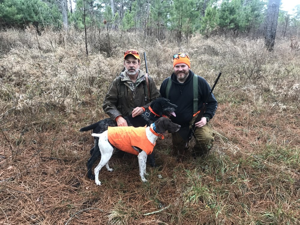 Taking a quick break to water the dogs during the morning hunt. Pictured are Billy (left), my brother Sean (right), and two of Billy's dogs, Paint (White) and Drake (Black).
