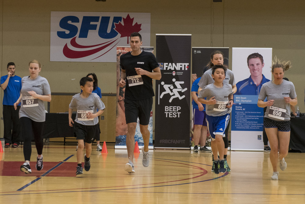 Olympian Scotty Dickens competes alongside some young athletes at a 2017 event.