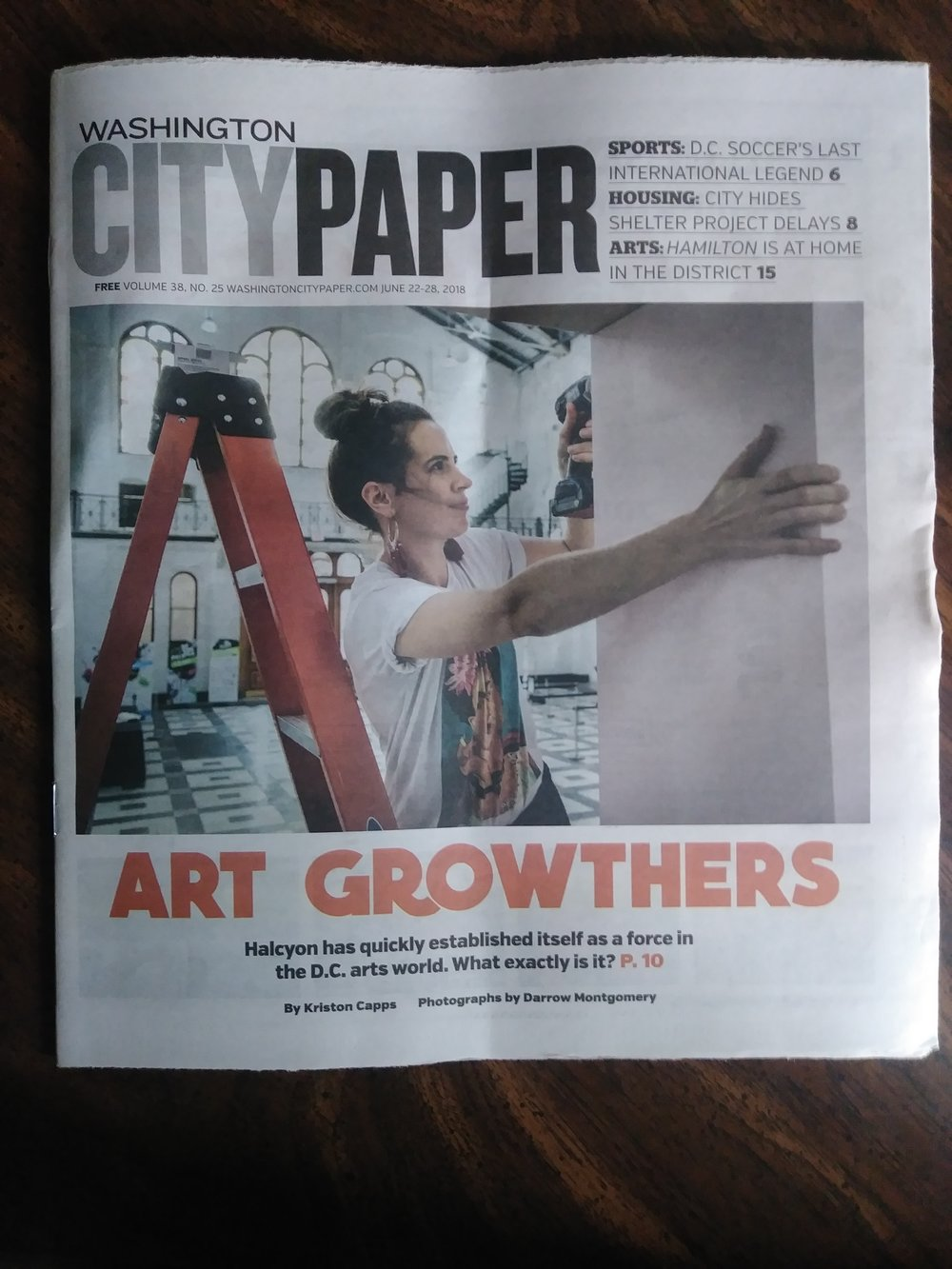 Saxelby on the cover of the  city paper , working on the arch we fabricated.