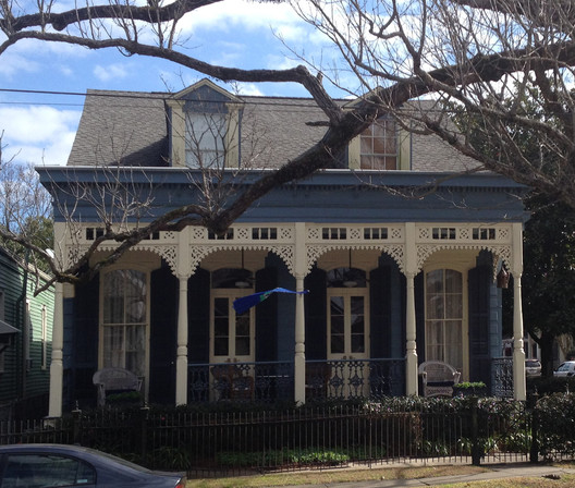 Double Shotgun House with a High Victorian Porch
