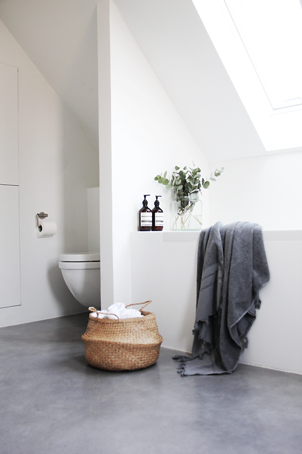 1. Grey is here to stay! - Not only is concrete flooring on trend, but it's a tactile, durable option that adds texture to a bathroom - Complement with cosy accessories and natural materials to add warmth.Image via The Style Files