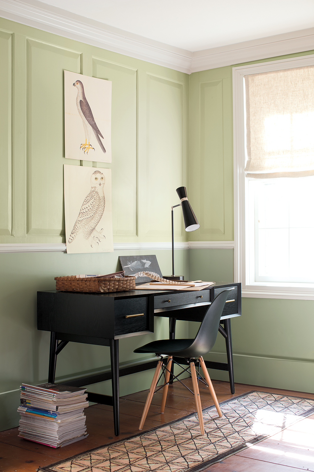 A lick of paint is guaranteed to brighten up your work space! - The two shades of green here from Benjamin Moore are refreshing and contrast perfectly against this stylish modern black desk!Image via Benjamin Moore Paint