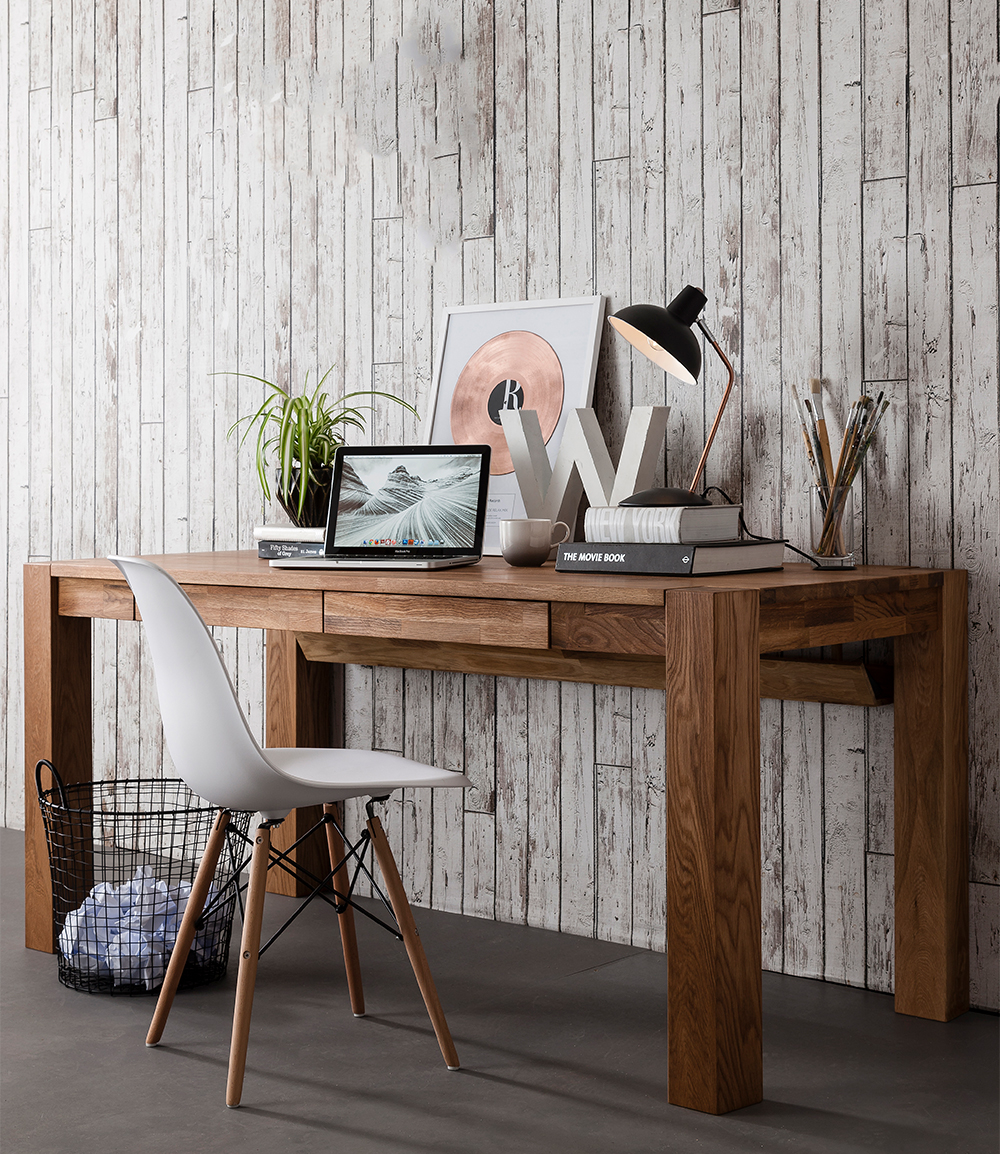 Get a good desk. - This chunky solid oak writing desk from Noa & Nani is an amazing find and offers a great amount of table top space for you to work on.Image via Noa & Nani