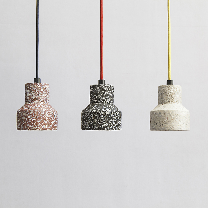Our pick of the bunch, these super cool terrazzo pendant lights are great for effortlessly introducing the trend into interiors. - Image via Elle Decoration