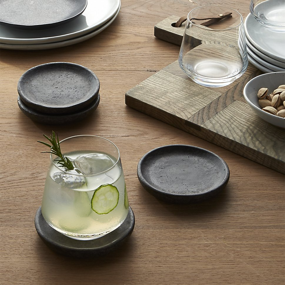 Cole Coasters - Weathered grey earthenware rounds protect furniture with a rustic modern charm. The Cole Coaster Set even comes wrapped in twine for easy gifting.£8.18 for 4Available at www.crateandbarrel.com