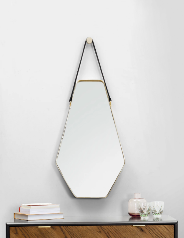 1. Made.com - Mirrors don't get much sassier than this Cora design from online retail giant, Made.com. Created by the brand's very own in-house design studio, the jewel-shaped mirror comes in two sizes, both of which are suspended from the brass wall fitting by a slick black leather strap. We're particular taken with the elegant plated brass frame, which offers a subtle touch of luxe without being gaudy. Take our word for it…your walls need this mirror!Cora Large Black & Gold Mirror: £129.00Cora Mirror Black & Gold £99.00www.made.com