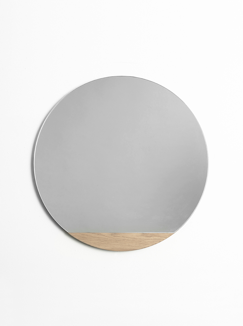 4. Another Country - If modern simplicity is your thing, then opt for the Chord round mirror from Another Country with its über sleek wood accent. Created by the talented Catherine Aitken Studio, Chord combines solid oak detailing with mirrored glass to add a characterful yet understated element to any interior space. Available in two oiled finishes of white and walnut, the subtle wood slice contrasts beautifully against the highly reflective surface, without detracting from the functionality of the mirror. We think it would sit beautifully above a dressing table or hung as a cool alternative to your standard bathroom mirror.Chord Mirror: £350.00anothercountry.com