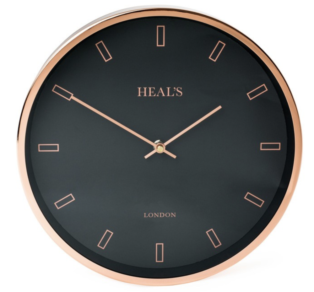 Heal's Black & Copper Wall Clock - This clock is inspired by an original 50's Smith's of London design. The clock features a copper finish case & black face paper with matching copper hands. Simplistic smart design. £49 at Heal's