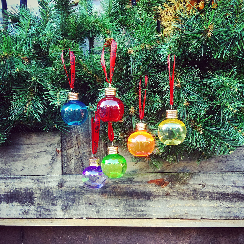Keep it tasteful - Fairy lights and tinsel can take a backseat this year; instead, why not inject a little merriment into your tree's overall look, by adding decorations that are more than just aesthetically pleasing? We love these gin-filled baubles from Pickering's in Edinburgh; fun, colourful and different, they'll be a real crowd pleaser come December 25th.