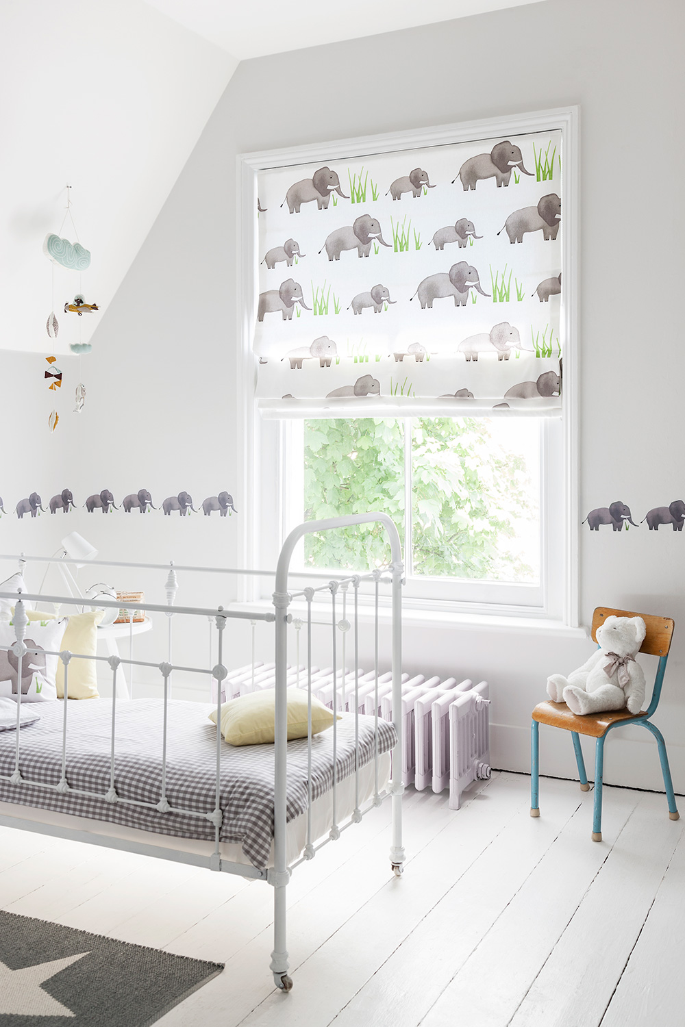 Creative window dressings - Bring fun and colour into your little one's room by adding some inspired blind solutions to the windows. This Elephant Carousel blind from Curtains.com is just the thing to stimulate their senses; with its soft, delicate design and tones, it will let plenty of light in and go perfectly with clean, fresh walls, cultivating an airy sense of space. For more inspiration and to browse all of their available options, visit www.curtains.com