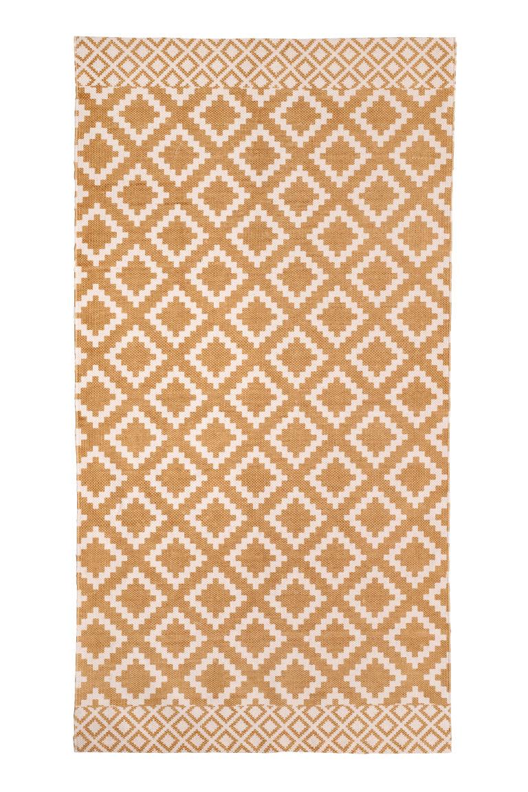 h&m yellow rug.jpeg