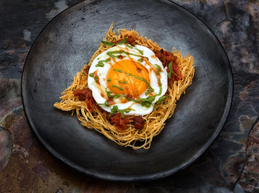 parsi _salli per eedu_, fried egg, crispy potatoes, chutneys.jpg