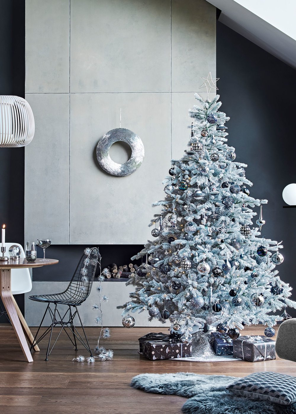 Cosmic Christmas - So you thought Santa in a speedboat was a bit out there, how about in a space ship? The cosmic Christmas decoration trend is full of futuristic pieces like iridescent reindeer, metallic stars and astronauts. This trend is a fun way to embrace a darker, monochromatic colour scheme this festive season.Image: John Lewis & Partners