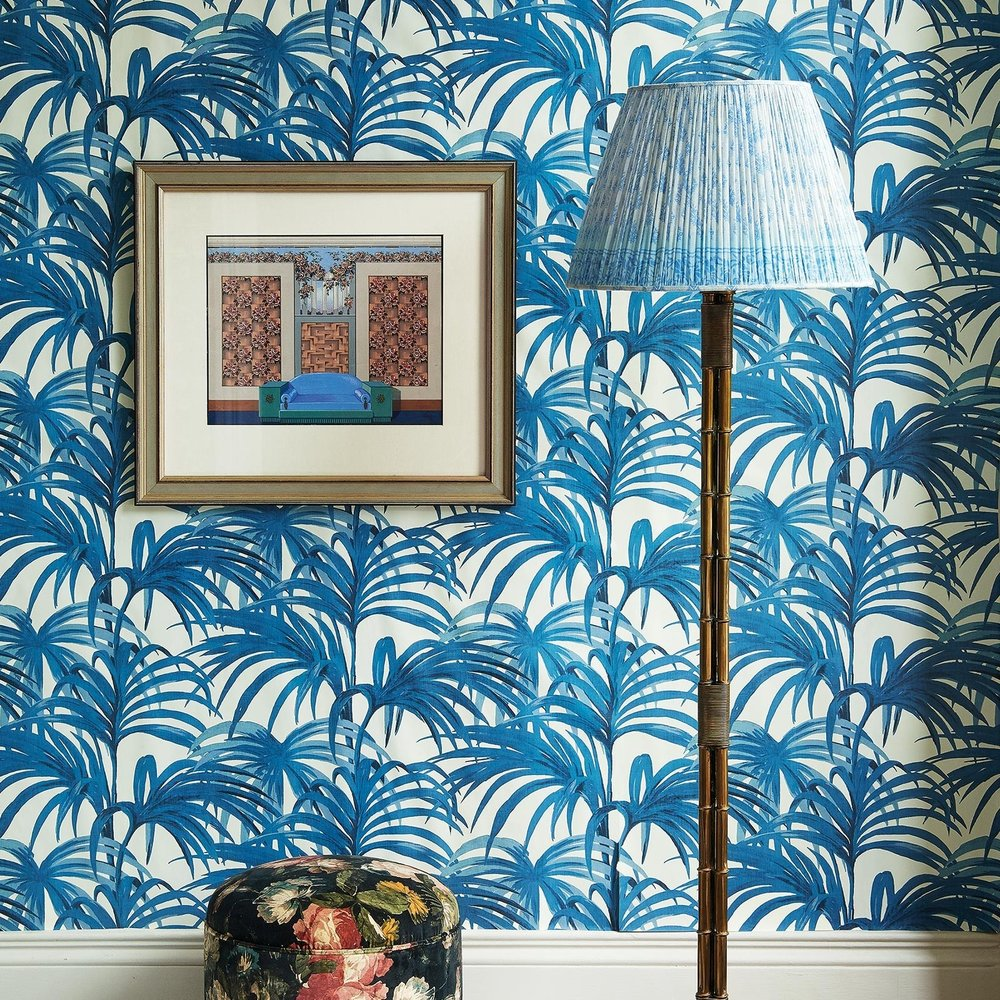 Palmeral - House of Hackney - As one of House of Hackney's most iconic prints, Palmeral takes its inspiration from one of the world's largest palm houses Loddiges, based in Hackney during Georgian times. Promising to turn the simplest of rooms into a lush greenhouse, Palmeral brings the outside in with a sea of chic palm leaves. £185.00Image: House of Hackney