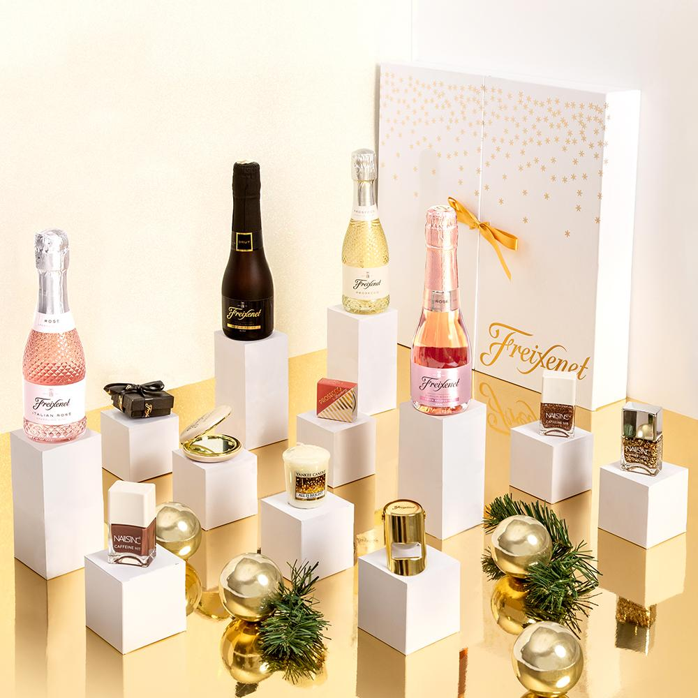 Freixenet Prosecco Advent Calendar - Made for lovers of both bubbles and beauty, the Freixenet advent calendar combines 20cl bottles of prosecco with beauty treats from Nails inc., prosecco lip balms and dreamy scented candles!£75.00