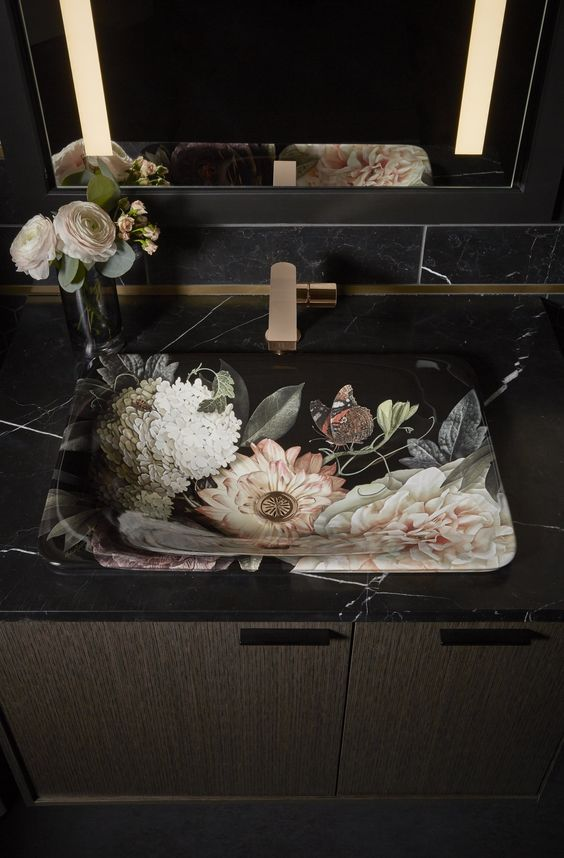 The Dutchmaster Sink - Created in collaboration with artist-photographer Ashley Woodson Bailey, Kohler's Dutchmaster collection takes 'bringing the outside in' to the next level. Inspired by the Dutch master paintings of the 17th century, the dramatic floral pattern sits against an alluring dark backdrop, making the basin a truly artistic statement piece for the bathroom.www.kohler.co.uk