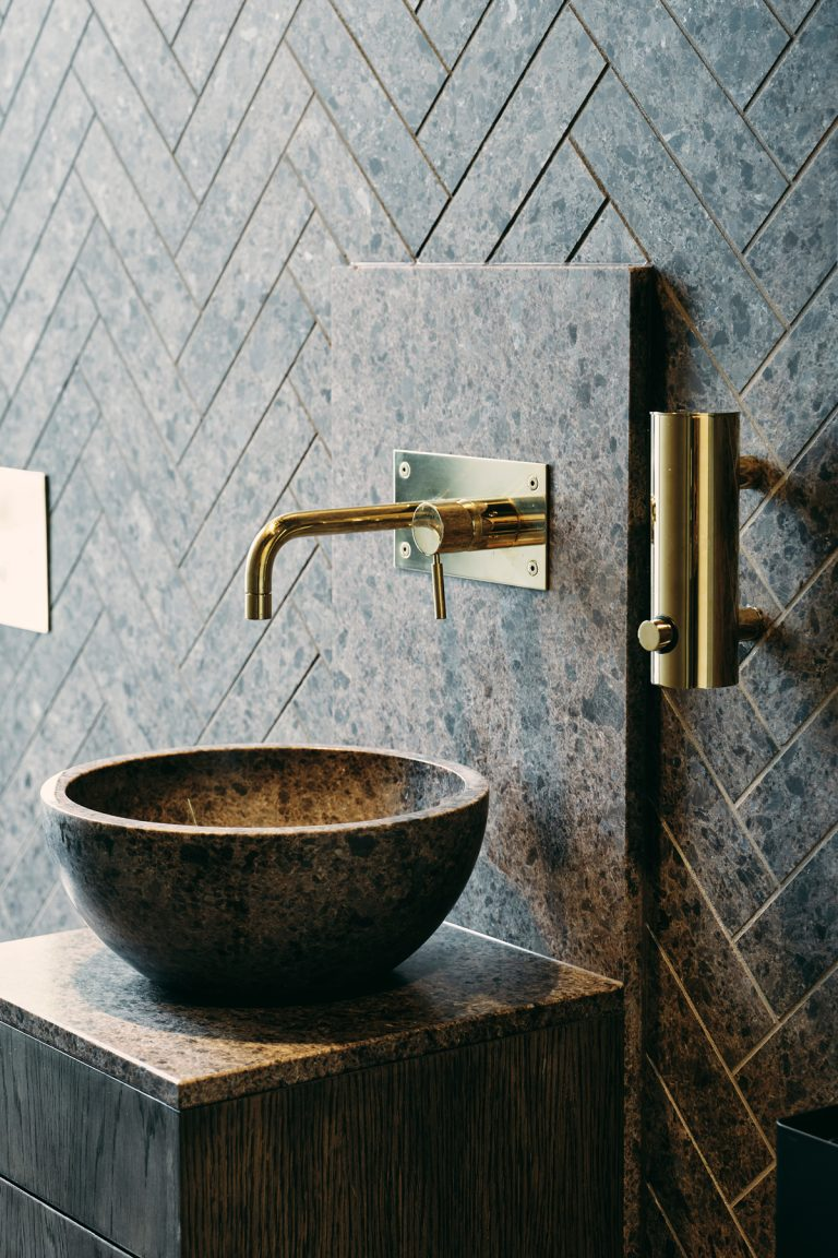 Lundhs Antique Basin - Crafted entirely from natural stone, this countertop basin from Norwegian natural stone specialists Lundhs Real Stone will add a striking finish to a modern bathroom space. Made from Anorthosite, the Lundhs Antique stone was formed 1000 million years ago on the west coast of Norway, meaning if you're lucky enough to have one of these in your house, you'll have your very own slice of Norway in your bathroom!https://lundhsrealstone.com/uk/