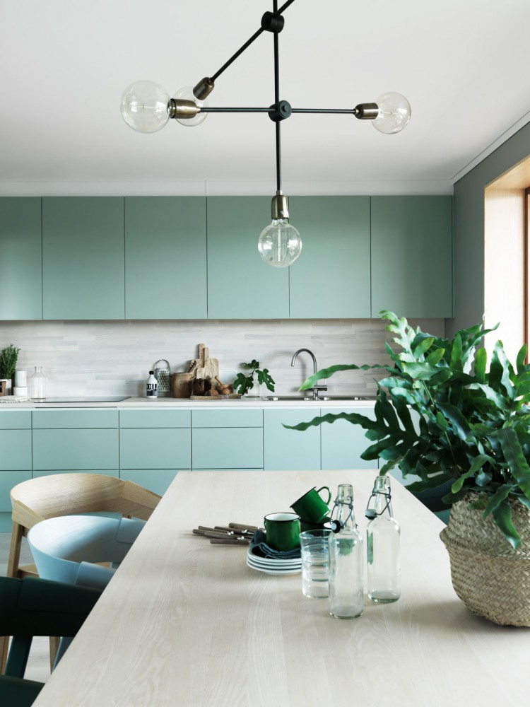 Take it to the kitchen - Whilst mint might not be the go-to colour for kitchen cabinetry, it's actually really effective in creating a refreshing and tranquil space. This effortlessly cool Swedish home, captured by photographer Jonas Ingerstedt, embraces the 'Mint' theme in every room! But we think the kitchen is where this colour really shines. Combined with pale, natural wood surfaces, these modern, handleless mint door fronts set the scene for a calm kitchen space.