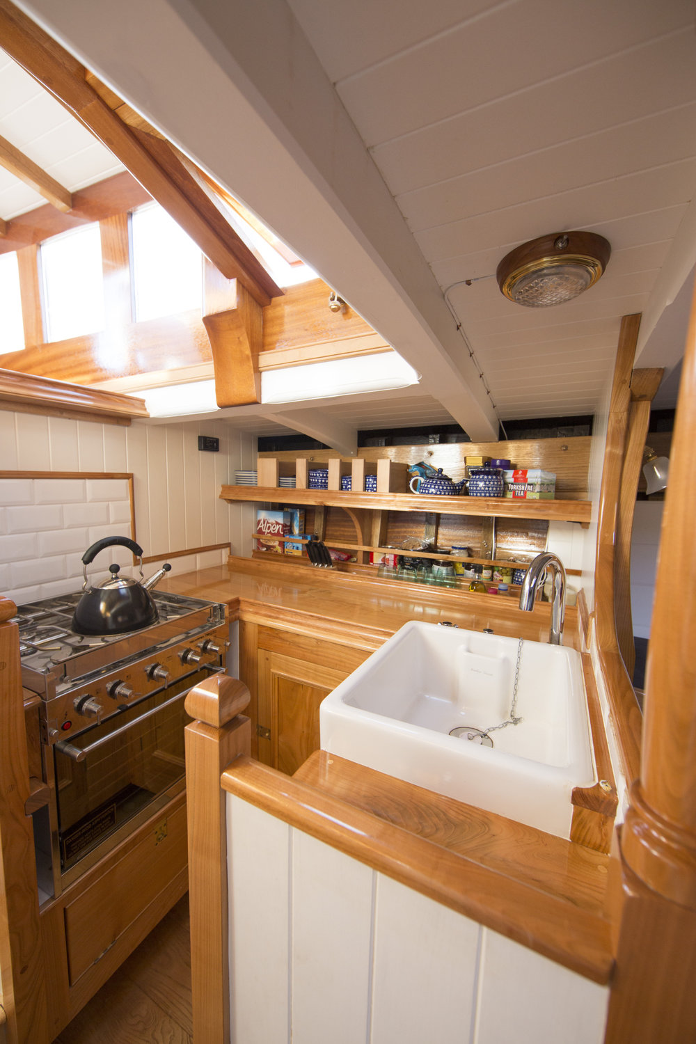 The galley, while compact, offers everything necessary for good, home cooked food © Mark Lloyd