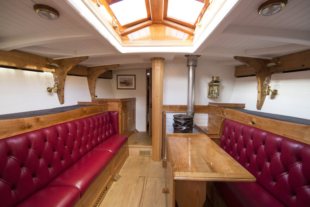 The saloon is spacious, the central skylight provides plenty of light, while a woodburner ensures the space is warm and relaxing © Mark Lloyd