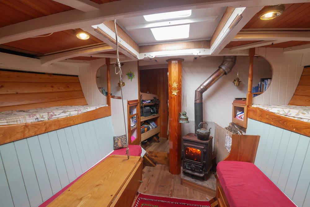 "The saloon with its wood burning stove is the heart of the boat                     Normal   0           false   false   false     EN-US   JA   X-NONE                                                                                                                                                                                                                                                                                                                                                                              /* Style Definitions */ table.MsoNormalTable 	{mso-style-name:""Table Normal""; 	mso-tstyle-rowband-size:0; 	mso-tstyle-colband-size:0; 	mso-style-noshow:yes; 	mso-style-priority:99; 	mso-style-parent:""""; 	mso-padding-alt:0cm 5.4pt 0cm 5.4pt; 	mso-para-margin:0cm; 	mso-para-margin-bottom:.0001pt; 	mso-pagination:widow-orphan; 	font-size:12.0pt; 	font-family:Cambria; 	mso-ascii-font-family:Cambria; 	mso-ascii-theme-font:minor-latin; 	mso-hansi-font-family:Cambria; 	mso-hansi-theme-font:minor-latin; 	mso-ansi-language:EN-US;}     © Hugh Hastings"