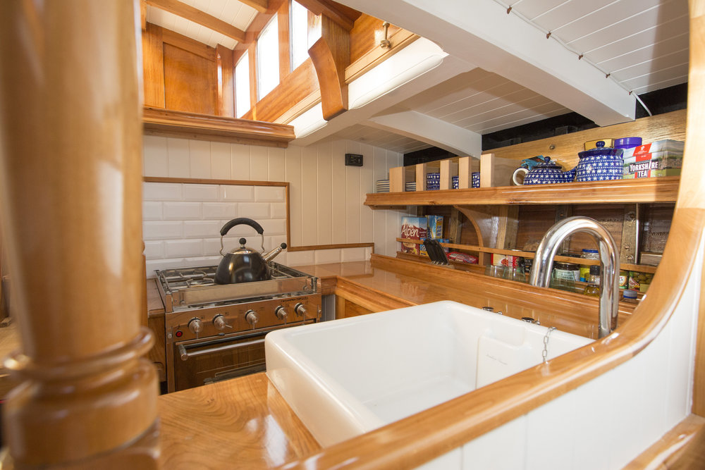 The galley of the Mayflowers is designed to be an ergonomic, pleasant workspace and the heart of the boat © Mark Lloyd