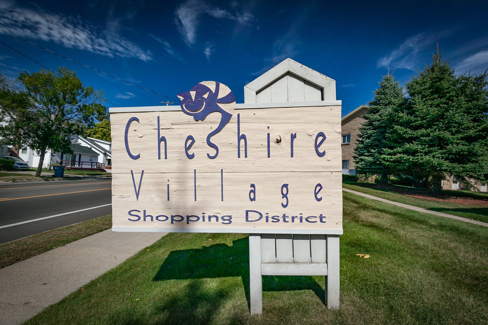 Cheshire Village  A charming area on the city's most northern end, Cheshire Village is a delightful business district nestled between appealing postwar residential homes and the Grand River.  Host to a specialty food market, pharmacy, bowling alley, and full-service and take out dining options; unique retail shops are joining the business mix.  Access couldn't be any more convenient as free parking and quaint design characteristics allow you to explore all of Cheshire Village by foot.