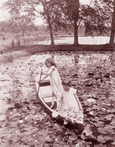 Young girls boating in Kenilworth Aquatic Gardens. 1930