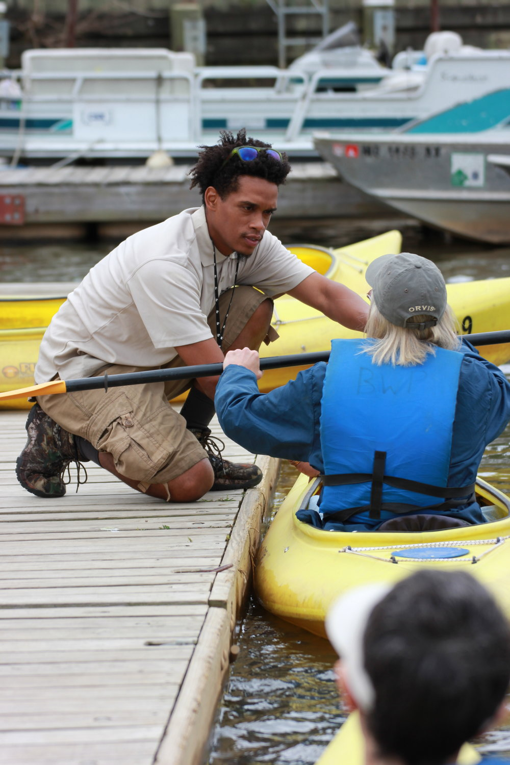 A kayak rental facility employee assists a customer at Bladensburg Waterfront Park. Photo: Anacostia Waterfront Trust.