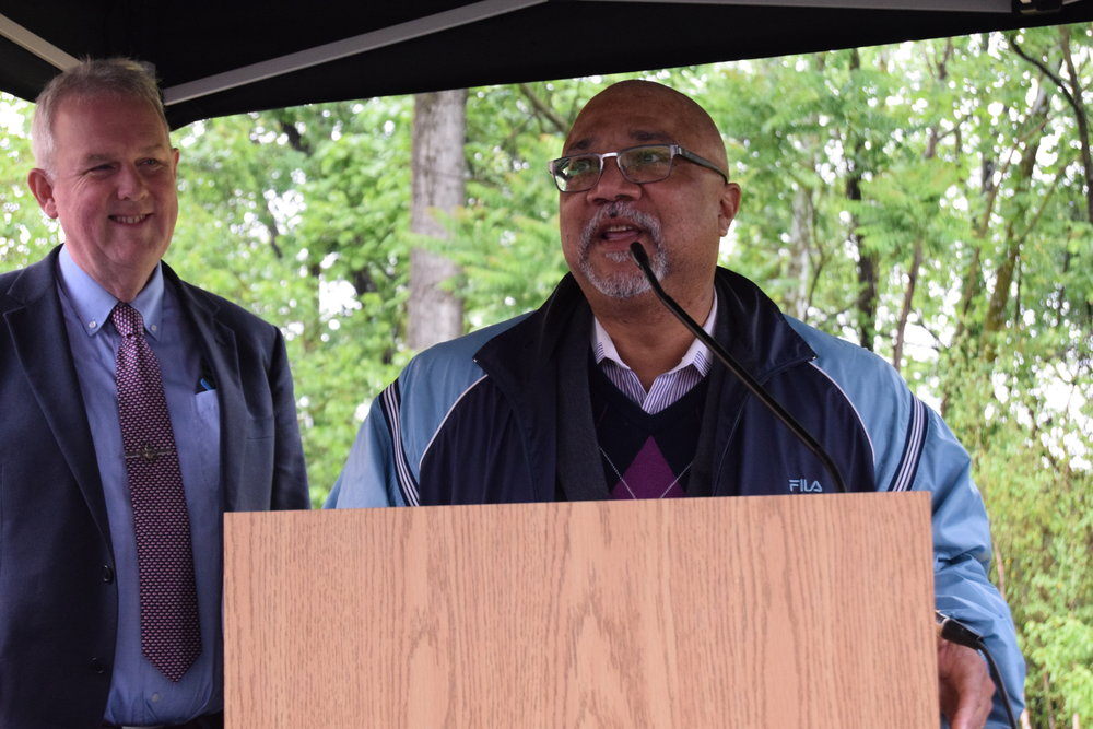 Dr. Timothy Tee Boddie speaks at the dedication as Department of Energy and Environment Director Tommy Wells looks on
