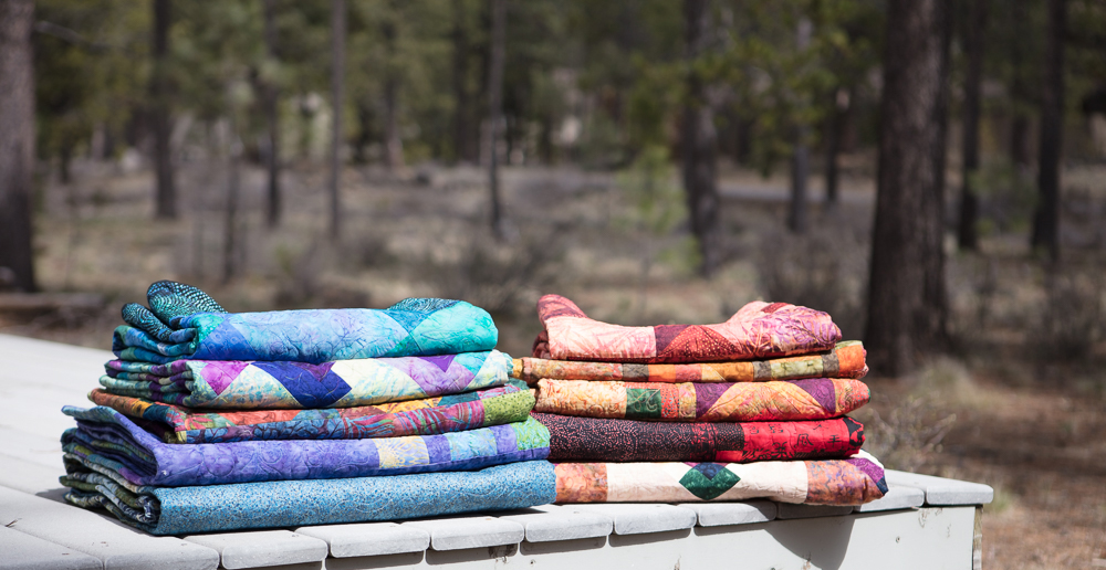 Quilts on the deck at QuiltSunriver